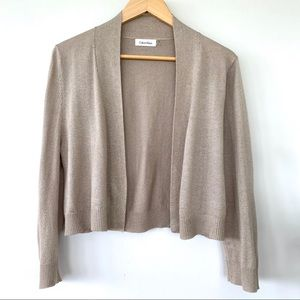 Calvin Klein cropped shrug with a hint of gold